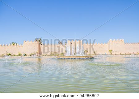 Big fountain in front of historic ramparts in Taurodant, Morocco