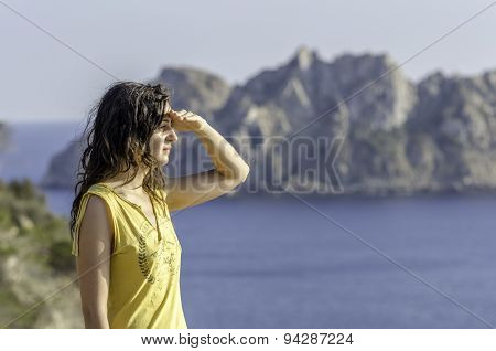Woman Looking With The Hand In Forehead And The Sea In The Background.