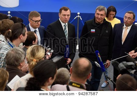 ST. PETERSBURG, RUSSIA - JUNE 20, 2015: General director of JSC Russian Grids Oleg Budargin (center) talk with press during the presentation of the project of the Federal Test Center