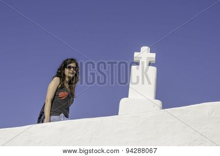 Girl And Cross With Blue Background.