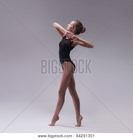 young beautiful dancer in black swimsuit