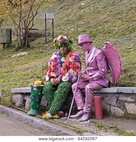 Two Unidentified Busking Mimes In Costumes Relax At Park In Kiev, Ukraine