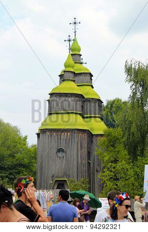 Ukrainian People Near Wooden Orthodox Church In Museum Pirogovo, Kiev, Ukraine
