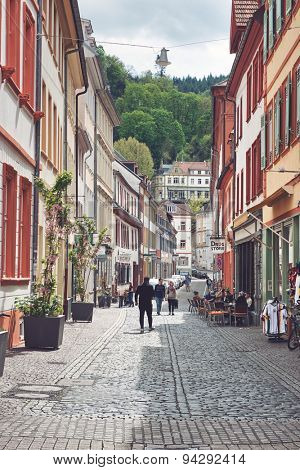 HEIDELBERG, GERMANY - APRIL 26: View of Picturesque Cobblestone Street Lined with Colorful Buildings in Heidelberg, Baden-Wurttemberg, Germany on April 26, 2015