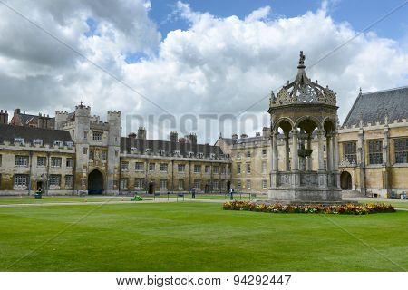 CAMBRIDGE, ENGLAND - MAY 13: Great Court, Trinity College, Cambridge University,Cambridge UK, with its historical fountain in the center of the courtyard in a landscaped garden on May 13, 2015