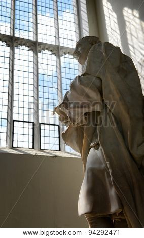 CAMBRIDGE, ENGLAND - MAY 13: Statue of Isaac Newton, Designed by Louis-Francois Roubiliac in 1775, Inside Trinity College Chapel at University of Cambridge, England on May 13, 2015