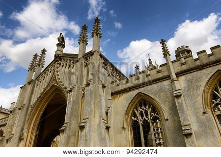 CAMBRIDGE, ENGLAND - MAY 13: Low Angle Architectural View of St Johns College New Court Gate Way Against Blue Sky with Clouds, University of Cambridge, England on May 13, 2015