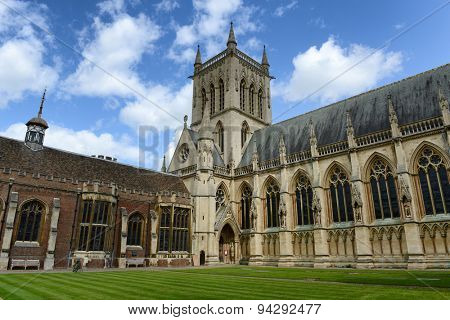 CAMBRIDGE, ENGLAND - MAY 13: Exterior and Entrance of St Johns College Chapel, Designed by Sir George Gilbert Scott in 1861, with Green Inner Courtyard and Blue Sky, Cambridge, England on May 13, 2015