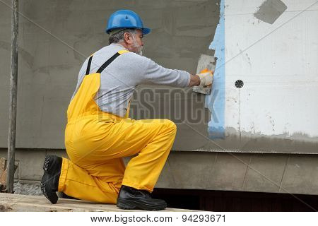 Wall Insulation, Spreading Mortar Over Mesh And Styrofoam