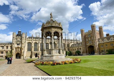 CAMBRIDGE, ENGLAND - MAY 13: View of the Great Court, Trinity, Cambridge University, Cambridge, UK and the ornate central stone fountain with the Kings Gate and Great Gate behind on May 13, 2015