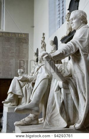 CAMBRIDGE, ENGLAND - MAY 13: Row of Statues Representing Some of the Greatest Minds in History Inside Trinity College Chapel at Cambridge University, England on May 13, 2015