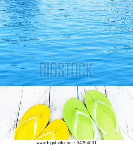 Colorful flip-flops on wooden boardwalk