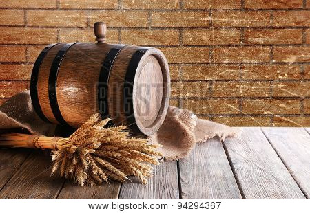Beer barrel with beer on table