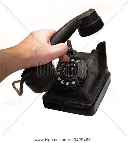 man hand hanging up the handset of an old black telephone