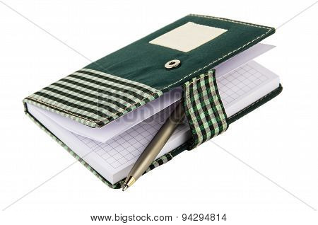 Opened Notepad In Checkered Cloth Cover With Clip And Ballpoint
