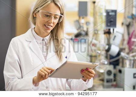 Chemist using tablet computer in the lab