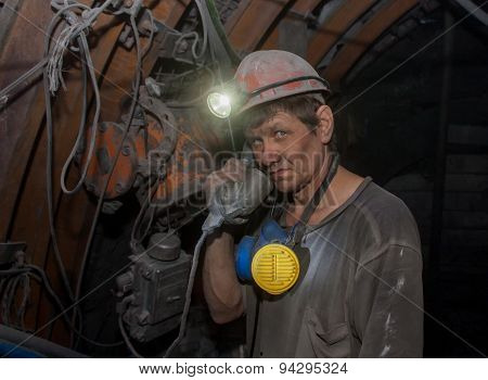 Donetsk, Ukraine - March, 14, 2014: Miner With A Phone In The Mine Named After Abakumov