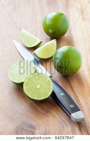 Limes On Cutting Board