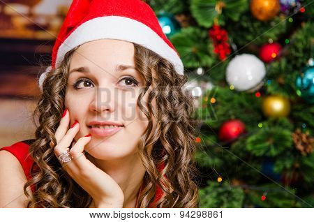 Portrait Of Dreaming Girl In A Christmas Setting