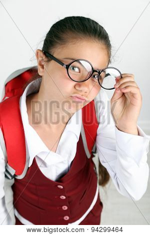Beautiful little funny schoolgirl