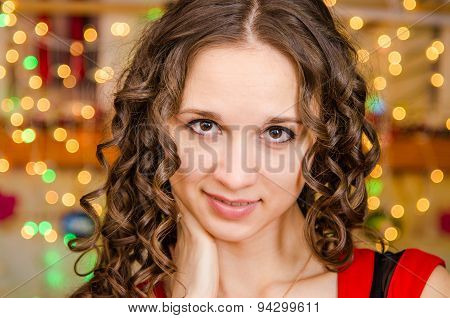 Portrait A Girl On Background Of Blurred Lights