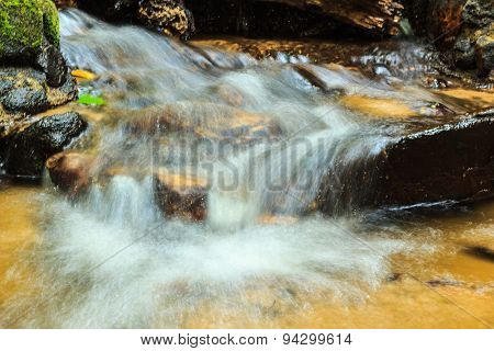 Creek Flowing Over The Rocks  For Background Or Others Purpose Use