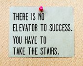 stock photo of elevator  - There is no Elevator To Success You Have to Take The Stairs written on paper note pinned with red thumbtack on wooden board - JPG