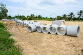 image of sewage  - Concrete drainage pipes stacked for construction irrigation industry - JPG