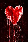 stock photo of broken heart  - Detail of the painted bleeding heart  - JPG