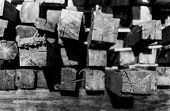 stock photo of lumber  - Closeup of piled up construction lumber in black and white with shadows - JPG