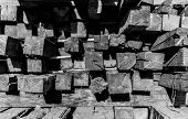 picture of lumber  - Piled up construction lumber in black and white with shadows - JPG