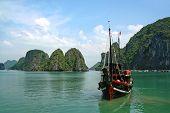 foto of junk  - A Junk boat in Halong Bay Vietnam - JPG