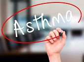 foto of asthma  - Man Hand writing Asthma with black marker on visual screen - JPG