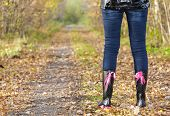 picture of woman boots  - detail of standing woman wearing black rubber boots - JPG