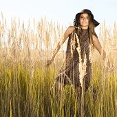 pic of tallgrass  - Young model in tallgrass meadow  - JPG
