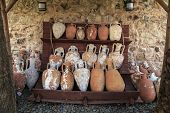 picture of jug  - Historical old clay jugs ancient mud pots on wooden shelf - JPG