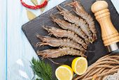 pic of tiger prawn  - Fresh raw tiger prawns and spices on wooden table - JPG