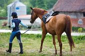 stock photo of horse-riders  - Rider with the horse in the rain at summer time - JPG