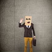 foto of anonymous  - Anonymous businessman against grey room - JPG