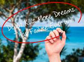 stock photo of killing  - Man Hand writing Doubt Kills More Dreams Than Failure Ever Will with black marker on visual screen - JPG