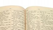 stock photo of bangla  - Close up of an open old Bengali Dictionary - JPG