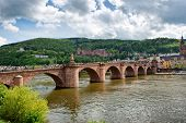 stock photo of old bridge  - Old Bridge Over Neckar River with View of Old Town Heidelberg - JPG
