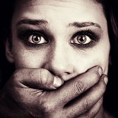 stock photo of domestic violence  - Scared woman victim of domestic torture and violence - JPG