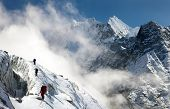 picture of mountain-climber  - group of climbers on mountains montage to mounts Kangtega and Thamserku Everest area Khumbu valley Nepal - JPG