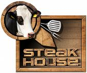 stock photo of cow head  - Wooden sign with text Steak House head of cow spatula and fork - JPG