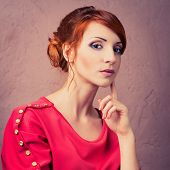 pic of young woman posing the camera  - Beautiful young fashionable woman posing in red dress looking at camera - JPG