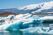 foto of iceberg  - Detailed photo of the Icelandic glacier icebergs in a ice lagoon with incredibly vivid colors and a nice texture - JPG