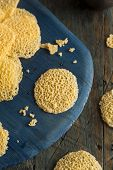 image of crisps  - Homemade Parmesan Cheese Crisps on a Cutting Board - JPG