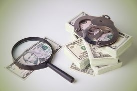 image of punish  - Finance and Law economic crime the punishment of the offender pack of dollars steel handcuffs horizontal image DSLR photography finance and law shadow capital punishment crime - JPG