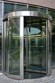 picture of revolver  - Modern revolving door as entrance to office building or hotel - JPG